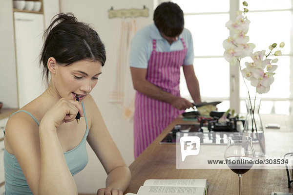 Woman working in kitchen  man cooking