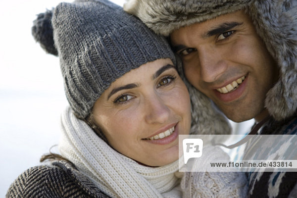 portrait of young couple in love outdoors in winter clothes