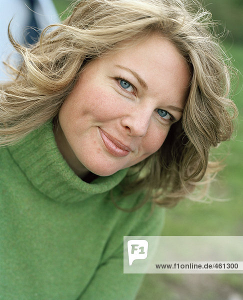 Portrait of a woman in a green sweater.
