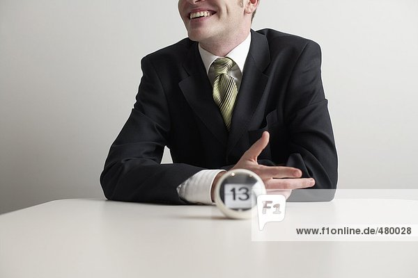 A date indicator in front of a businessman