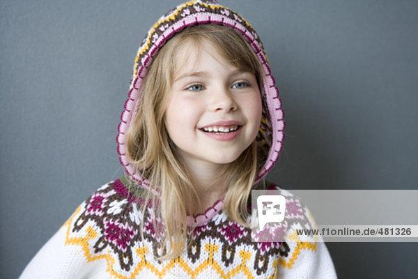 portrait of little girl in jumper with hood