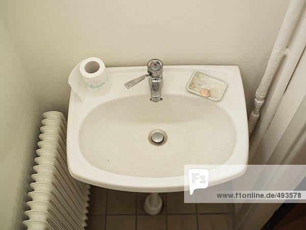 A washbasin in a bathroom.