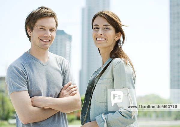 Young couple smiling in urban area