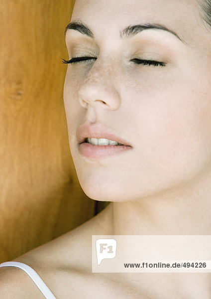 Young woman's face with eyes shut  close-up