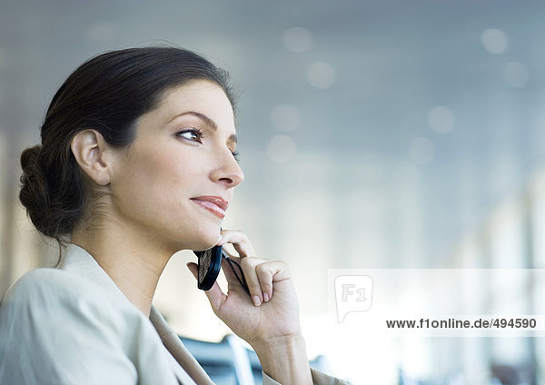 Businesswoman using cell phone  low angle view
