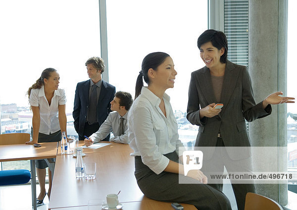 Business colleagues standing  discussing