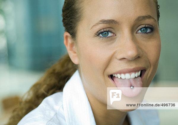 Professional woman  showing pierced tongue  portrait