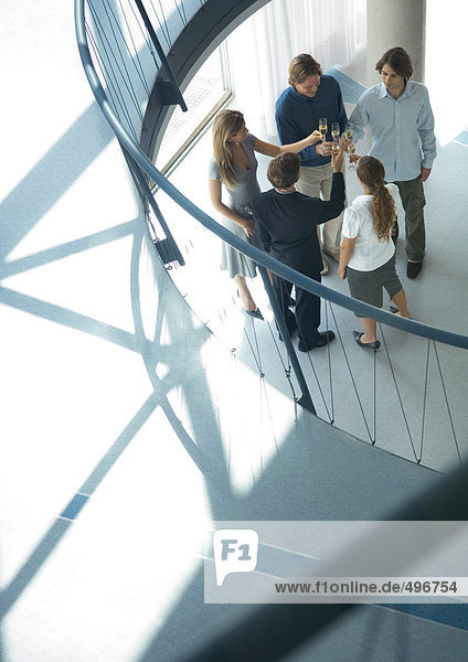 Group of young executives making toast  high angle view