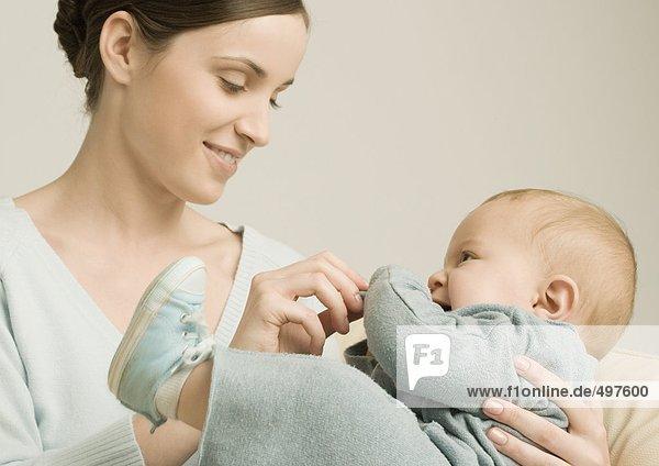 Mother feeding baby
