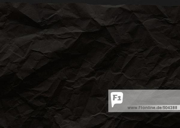 Gefaltetes dunkles Papier  Nahaufnahme