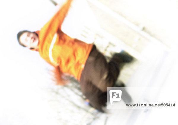 Teenager Junge springend  Bewegung  verschwommen