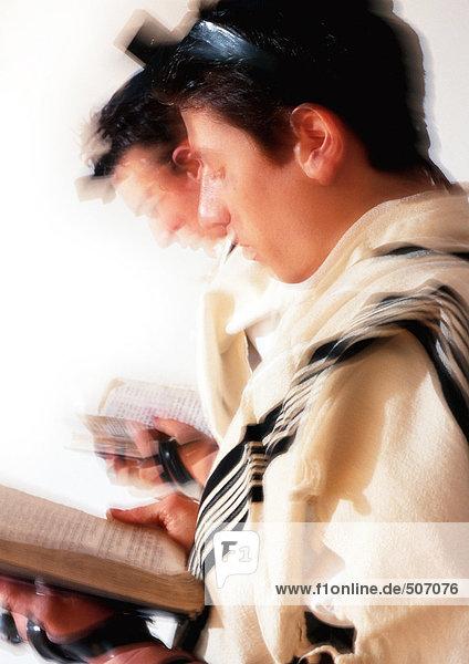 Jewish men praying  blurry.