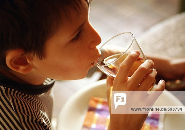 Child drinking  side view  close-up