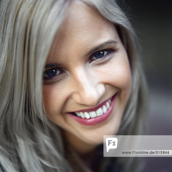 Woman looking at camera  smiling  portrait