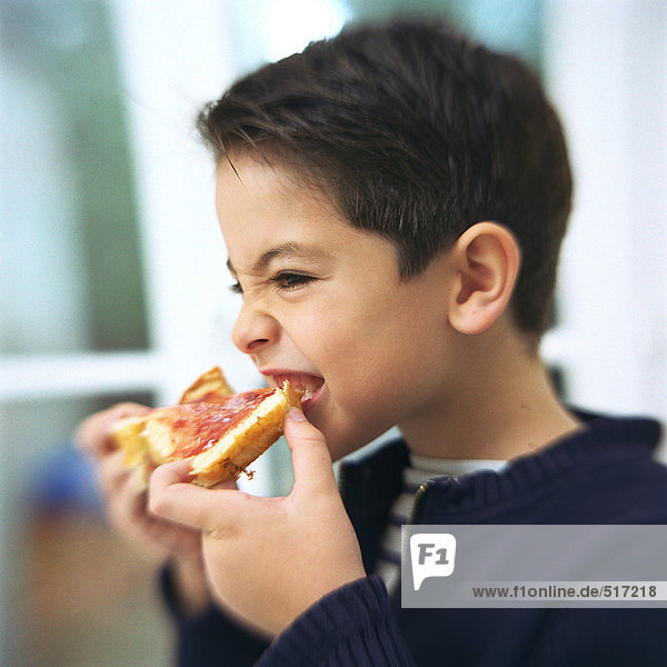 Boy eating slice of bread and jam  portrait