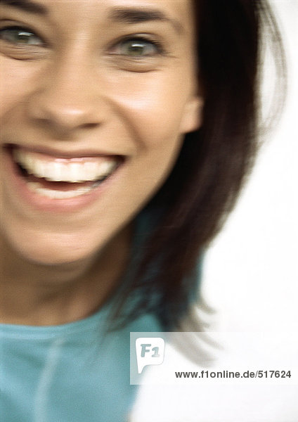 Woman smiling at camera  close up  blurred portrait