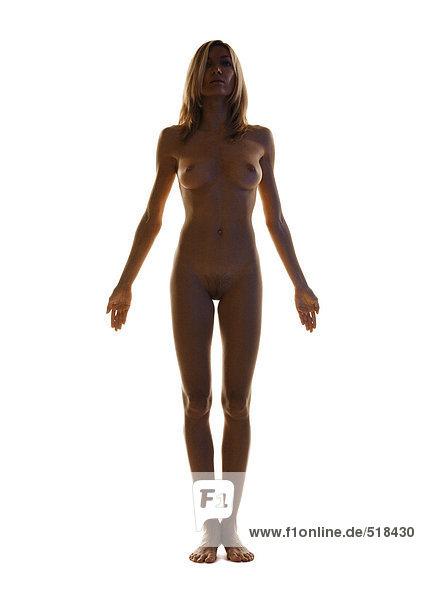 Nackte Frau stehend,  Arme ausstreckend,  volle Länge