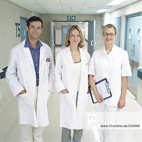 Medical staff standing in hospital corridor