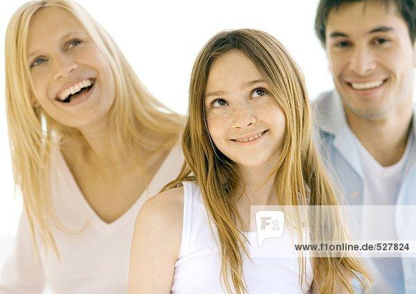 Mädchen mit Eltern  Portrait