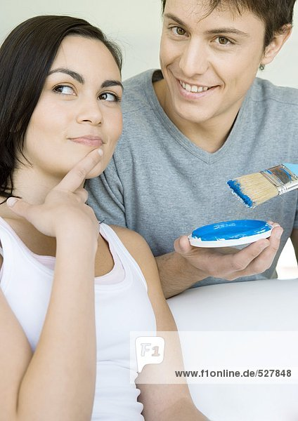 Couple deciding on paint color