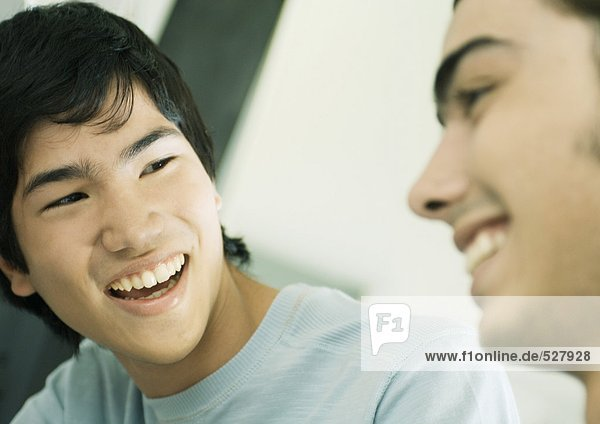 Two young men smiling
