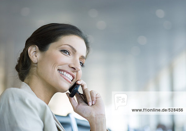 Woman using cell phone  smiling