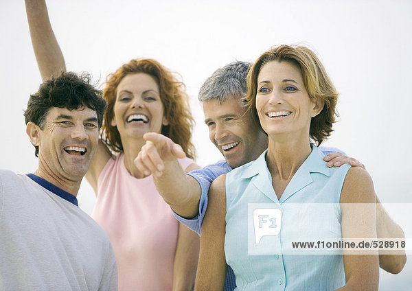 Two mature couples laughing