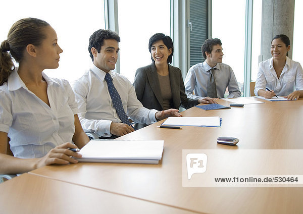 Business associates sitting at conference table