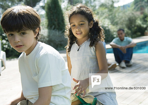 Boy and girl playing outdoors