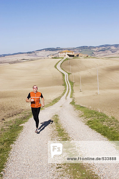 Italy  Tuscany  man jogging