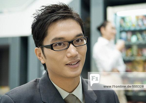 Businessman in break room  portrait