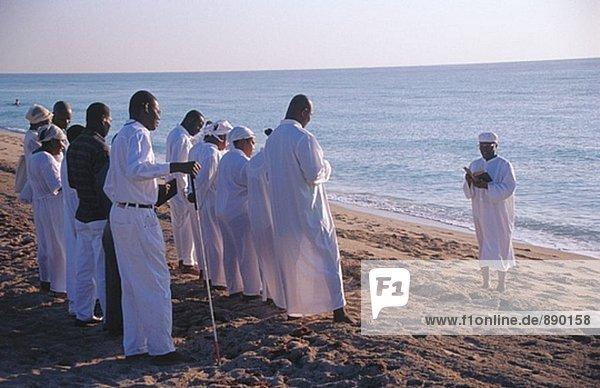 Haitian baptism ceremony. Miami Beach. Florida. USA