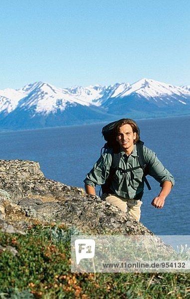Hiker along Turnagain Arm in summer. Chugach State Park. Alaska