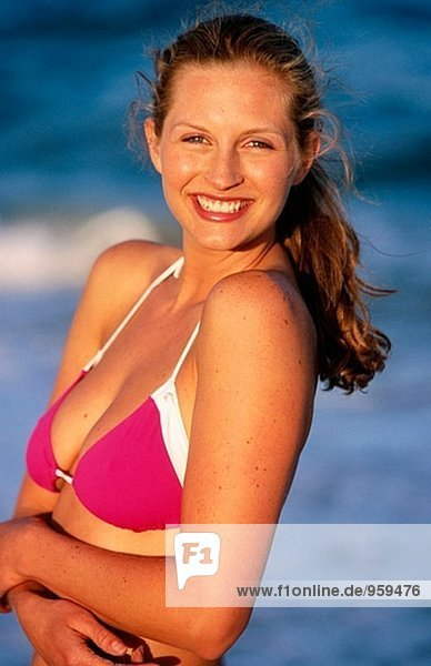 Smiling young woman at the beach