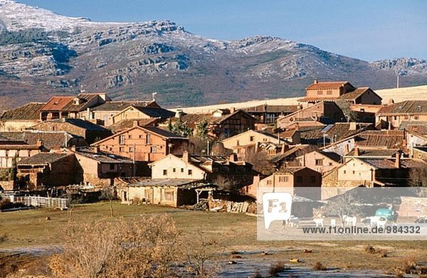 Overview of Madriguera with Ayllon mountain range at background. Segovia province. Spain