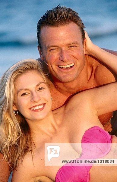 smiling beach couple