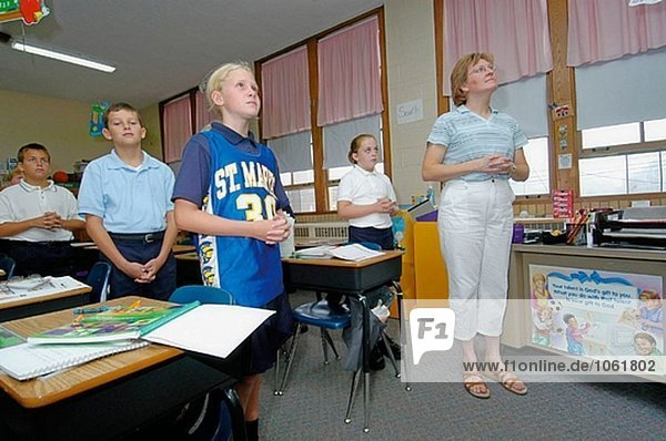 Teacher in religious class training in a Catholic elementary school