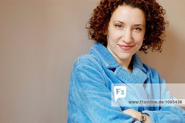 Smiling woman in a blue robe.