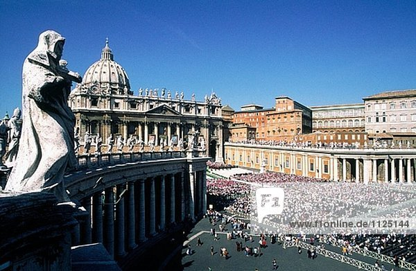 Attending a mass with the Pope under bright sun. St. Peter square. Vatican. Rome. Italy.