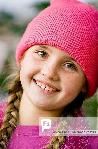 Smiling girl with cap
