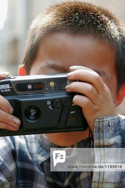 Chinese boy with photo camera