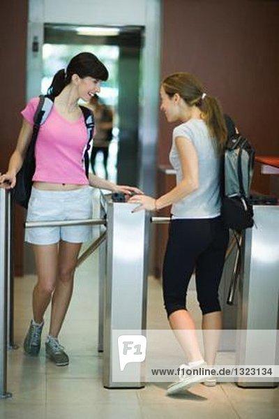 Young women entering health club