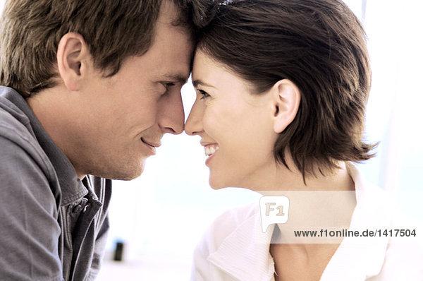 Portrait of couple  head to head  view in profile