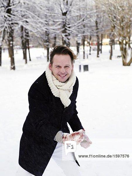 A man holding a snowball Stockholm Sweden.
