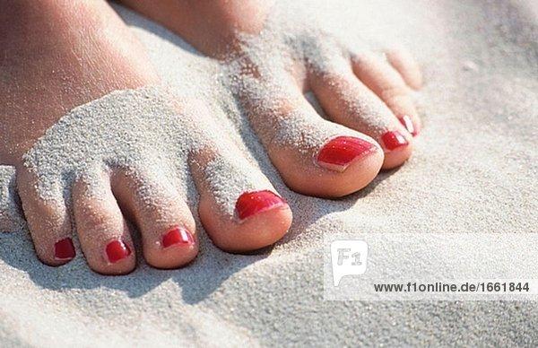 Feet. Summer  beach  sand. North Sea. Schleswig-Holstein. Germany.