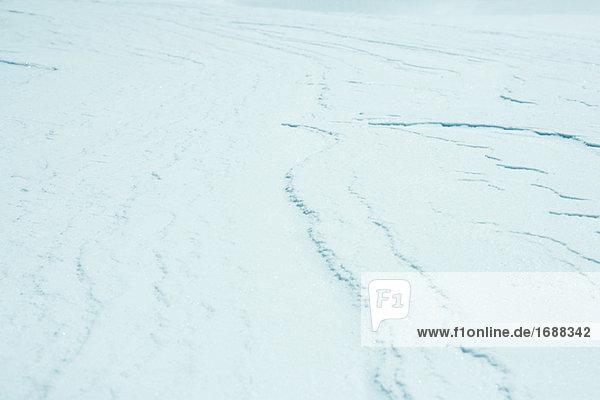 Snow covered land  full frame