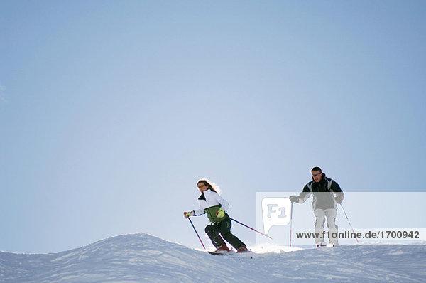 Austria  Salzburger Land  Couple skiing in mountains