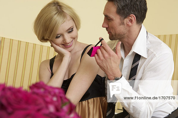 Man giving young woman a present