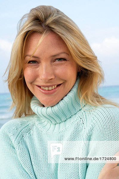 Portrait of a woman in a light blue turtleneck pullover