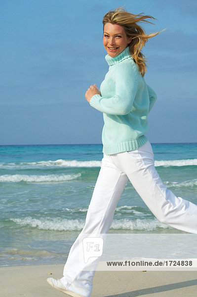 Running woman on the beach